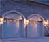 Two single car garage doors at night, available for sale in Portland Oregon by Fairview Garage Doors.